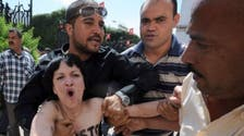 Little sympathy as topless protesters face Tunis trial