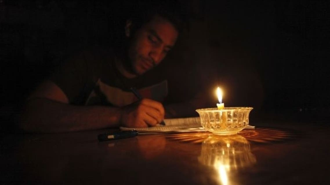 Mostafa Khaled, 20, studies by candlelight for his early morning exams during a power cut in Toukh, El-Kalubia governorate, about 25 km (16 miles) northeast of Cairo . (Reuters)