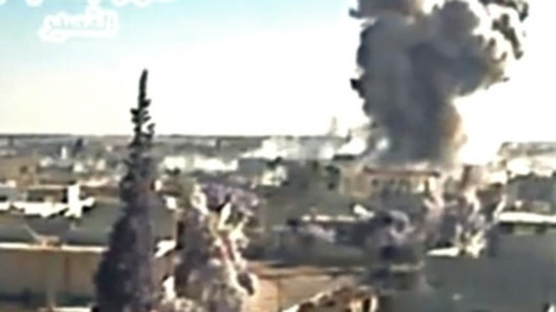 A image grab taken from a video uploaded on Youtube by Al-Qusayr Media Centre on May 26, 2013 allegedly shows smoke billowing from buildings in the city of Qusayr, in Syria's central Homs province, following an airstrike by government forces. (AFP)