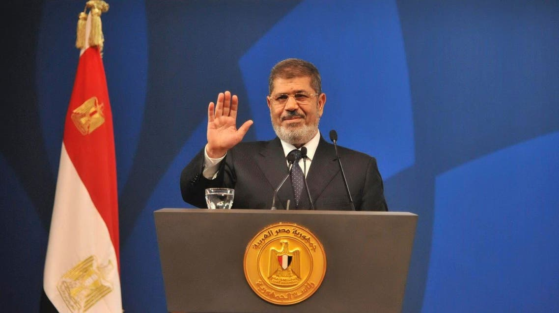 Egyptian President Mohamed Mursi speaks in a conference and exhibition organised by civil society organizations in Cairo in this handout picture provided by the Egyptian Presidency dated May 29, 2013. (Reuters)