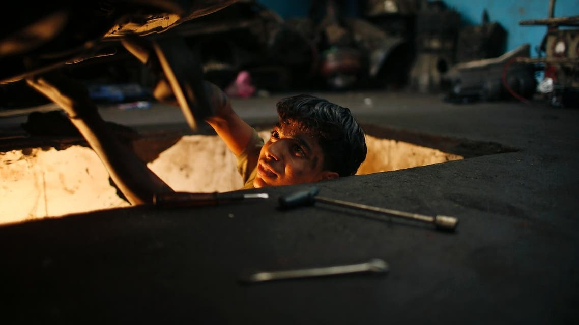 Apprentice mechanics in Gaza City