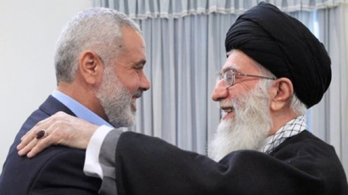 In this photo provided by an official website of the Iranian supreme leader's office, supreme leader Ayatollah Ali Khamenei, right, greets Hamas' Ismail Haniyeh, in Tehran, Feb. 12, 2012. (Photo courtesy of AP)