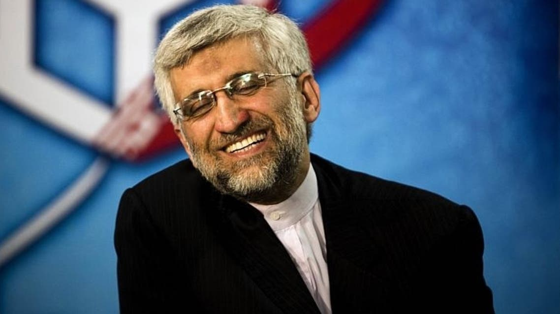 ran's chief nuclear negotiator Saeed Jalili smiles as he registers his candidacy for the upcoming presidential election at the interior ministry in Teheran, on May 11, 2013. AFP