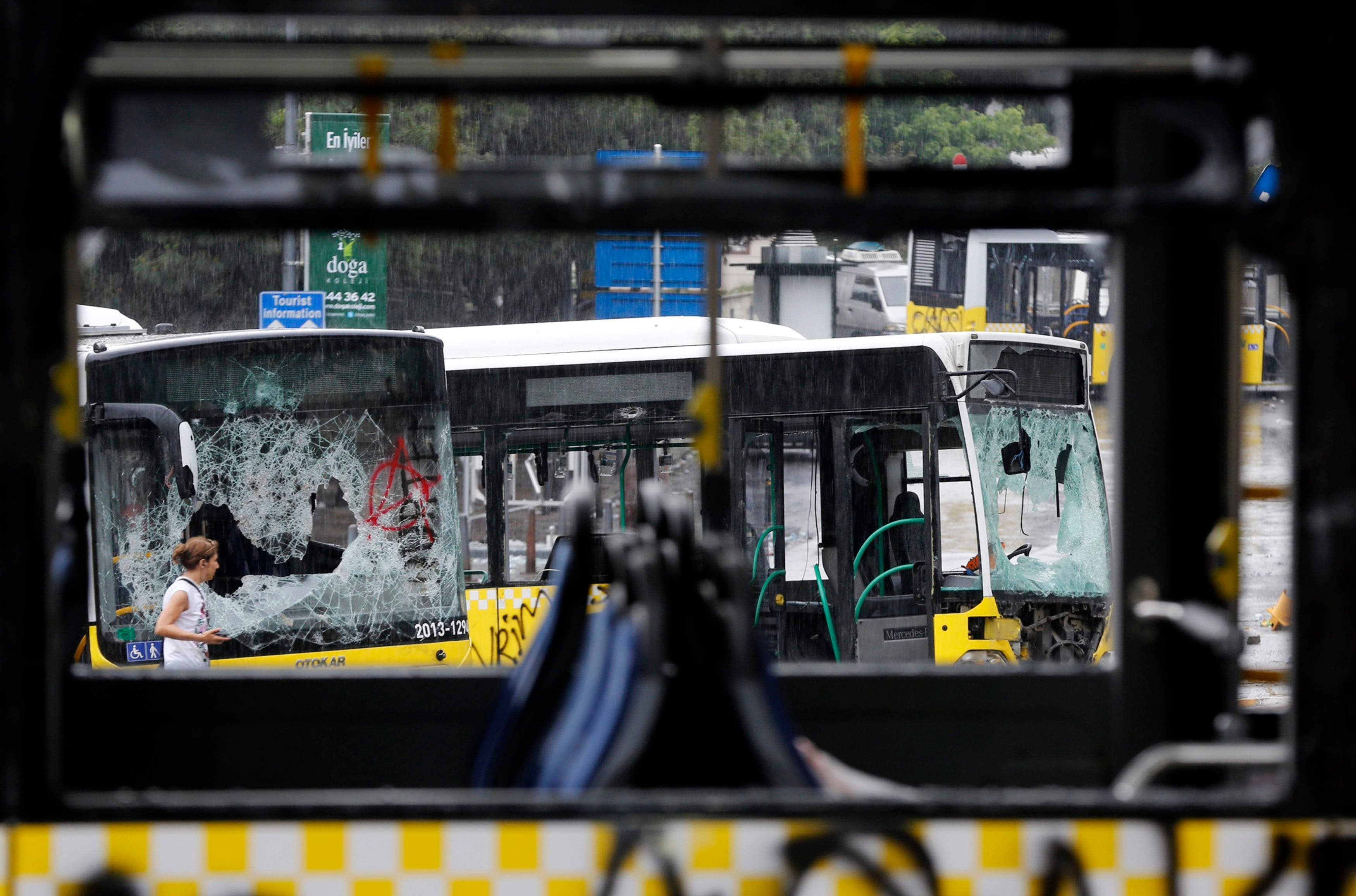 Damaged buses are seen in Taksim where police and anti-government protesters clashed in central Istanbul June 2, 2013. (Reuters)