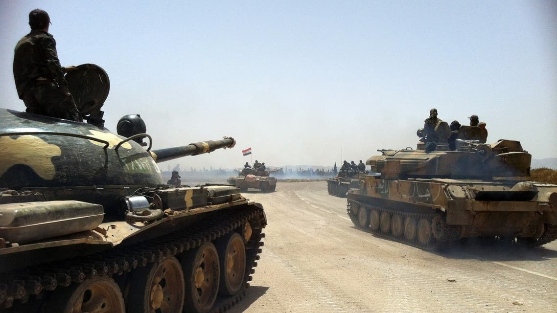 This photo taken by mobile phone on June 2, 2013 shows Syrian army tanks making their way to the Dabaa military airfield, north of the Syrian city of Qusayr. (AFP)