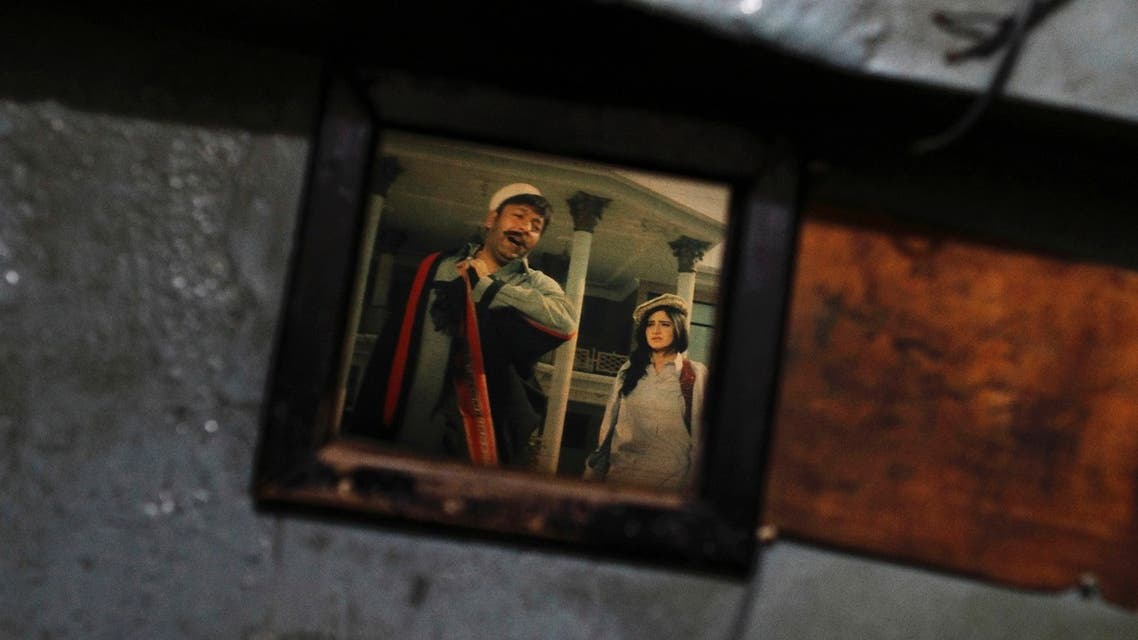 A scene of an old Pashto movie is seen through a window at Arshad cinema in Peshawar May 27, 2013. (Reuters)
