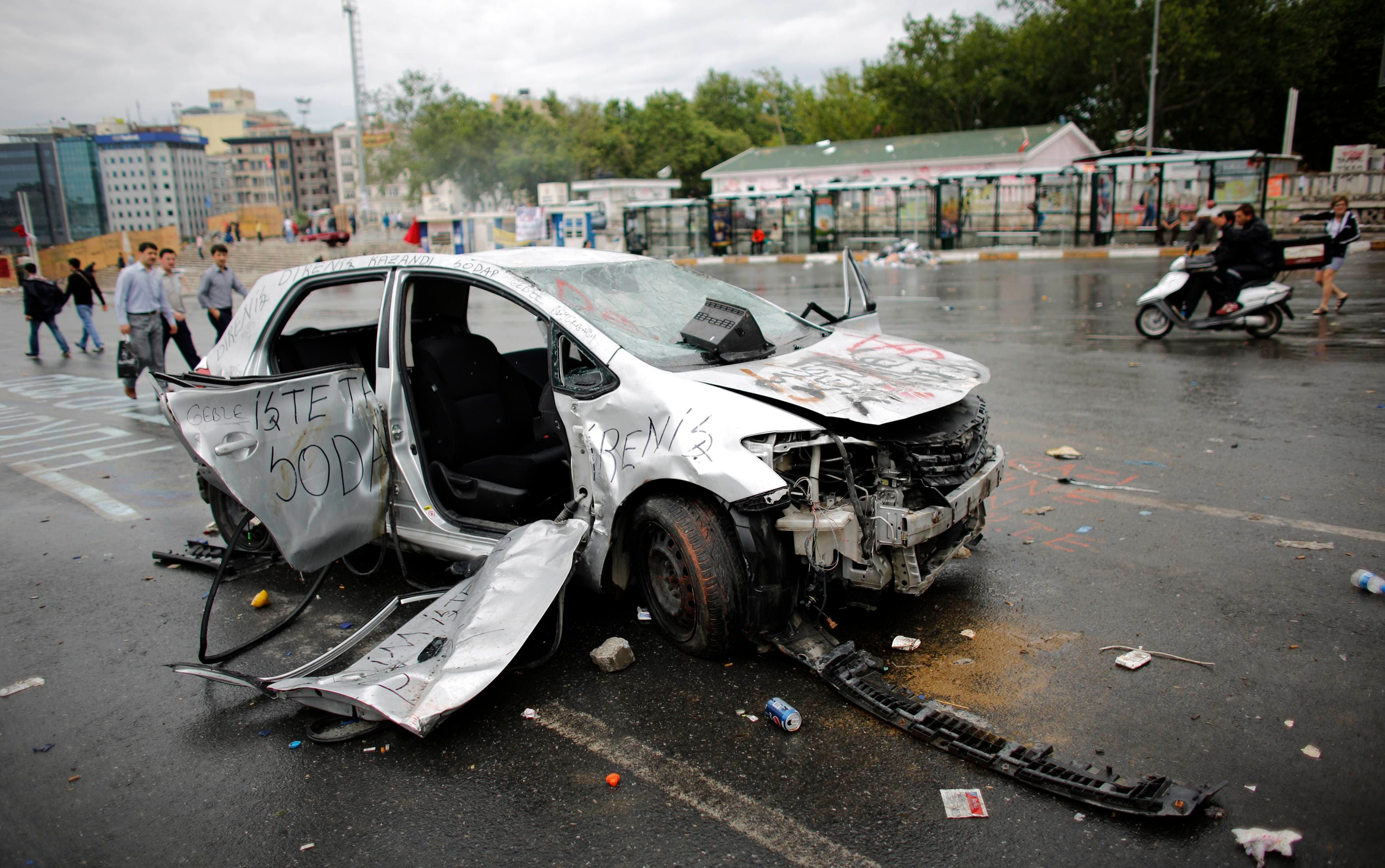 Damaged car is seen in Taksim where police and anti-government protesters clashed in central Istanbul June 2, 2013. (Reuters)