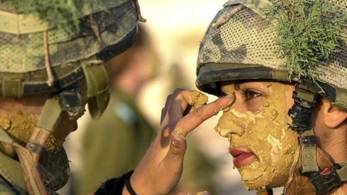 Women serve two years in the Israeli forces — although some try to dodge it. (AFP)