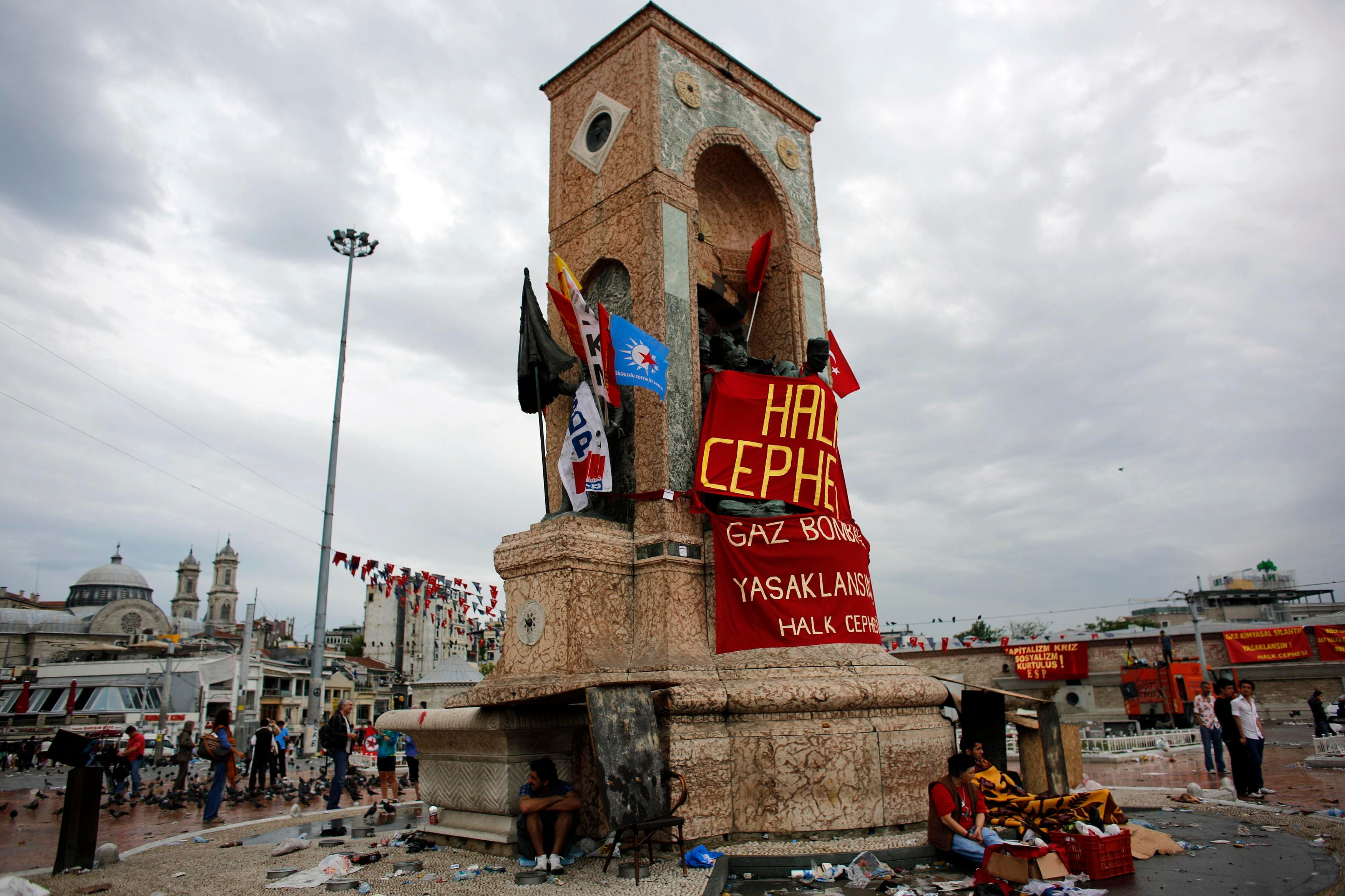 Demonstrators rest in Taksim Square where police and anti-government protesters clashed in central Istanbul June 2, 2013. (Reuters)