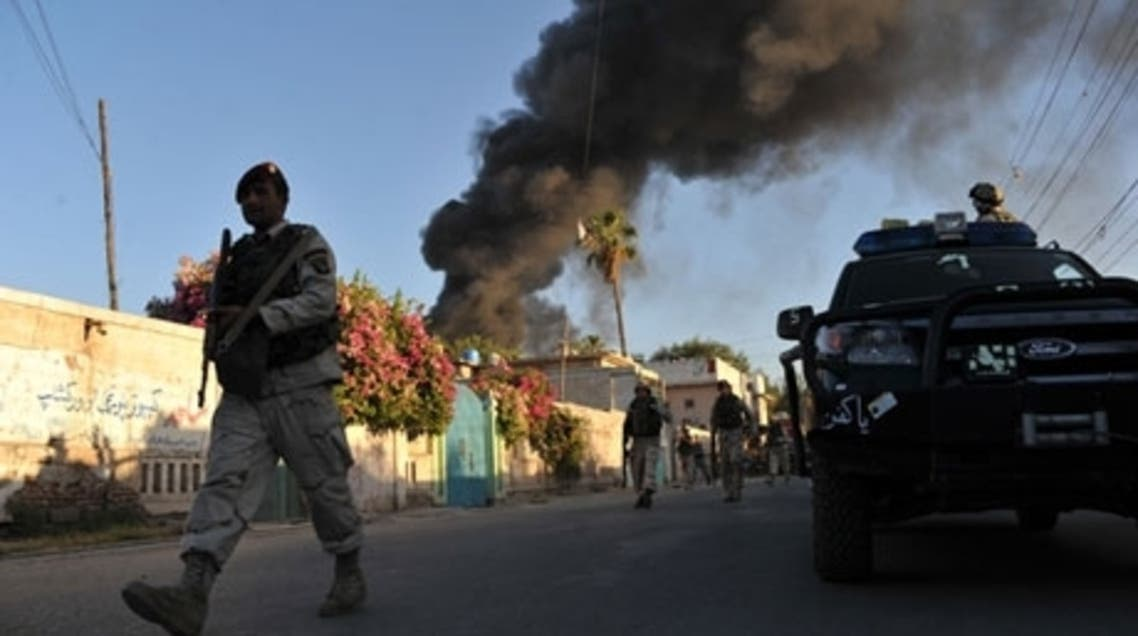 Smoke rises from the ICRC's compound in Jalalabad, eastern Afghanistan, following Wednesday's attack. (AFP)