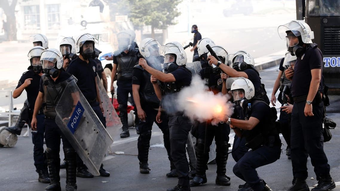 Riot police fire tear gas against protesters during a demonstration in Ankara June 3, 2013. REUTERS