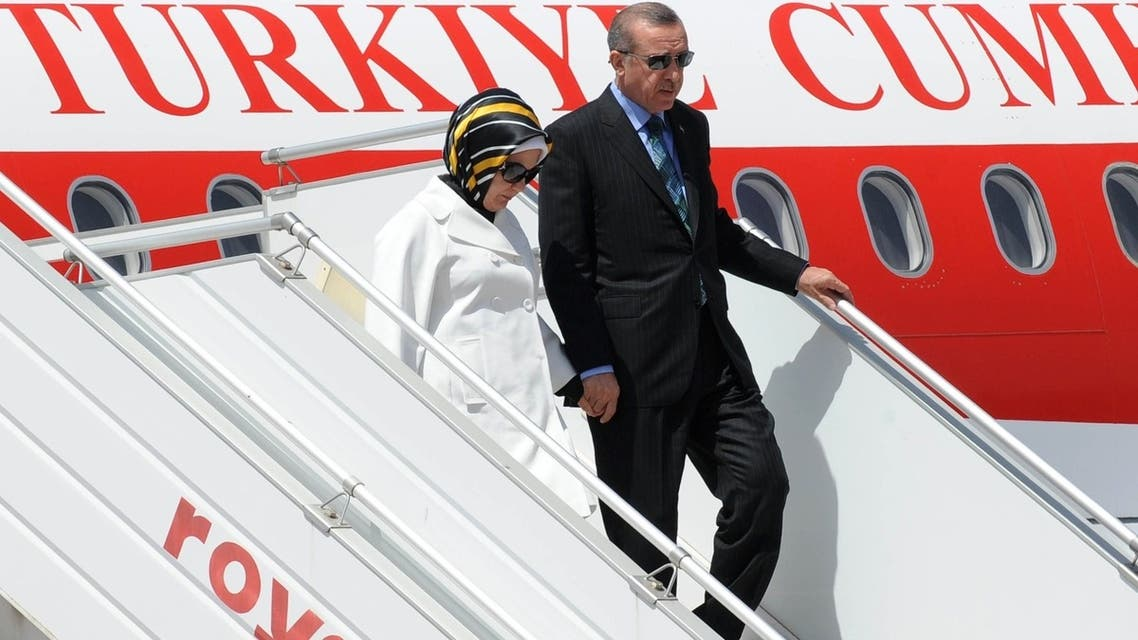 Turkish Prime Minister Recep Tayyip Erdogan and his wife Emine arrive at Rabat airport on June 3, 2013 at the start of a tour of the Maghreb region as unprecedented anti-government protests swept Turkey. (AFP)