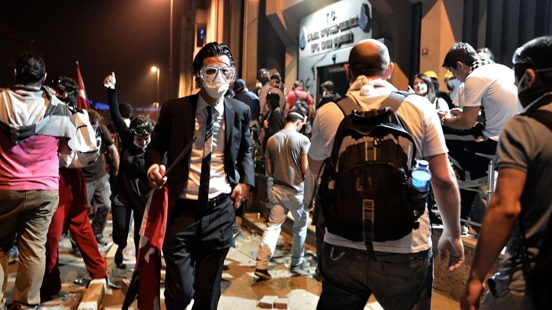 TOPSHOTSA man leaves from clash site between Taksim and Besiktas in Istanbul on June 4, 2013 during a demonstration against the demolition of the park.  (AFP)