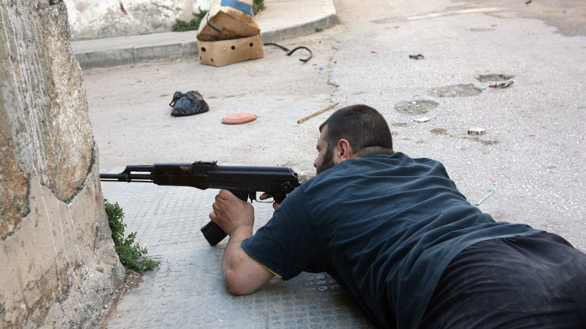 A fighter takes position in the al-Qobee neighborhood of the city of Tripoli on June 3, 2013. (AFP)
