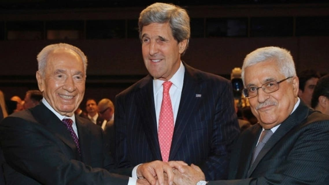 US Secretary of State John Kerry (C) shakes hands with Israeli President Shimon Peres (L) and Palestinian President Mahmoud Abbas at the World Economic Forum on the Middle East and North Africa at the King Hussein Convention Center, at the Dead Sea, May 26, 2013. (photo by REUTERS/Jim Young)  Read more: http://www.al-monitor.com/pulse/originals/2013/06/abbas-demands-negotiations-based-on-the-1967-borderlines.html#ixzz2VESfmFKB