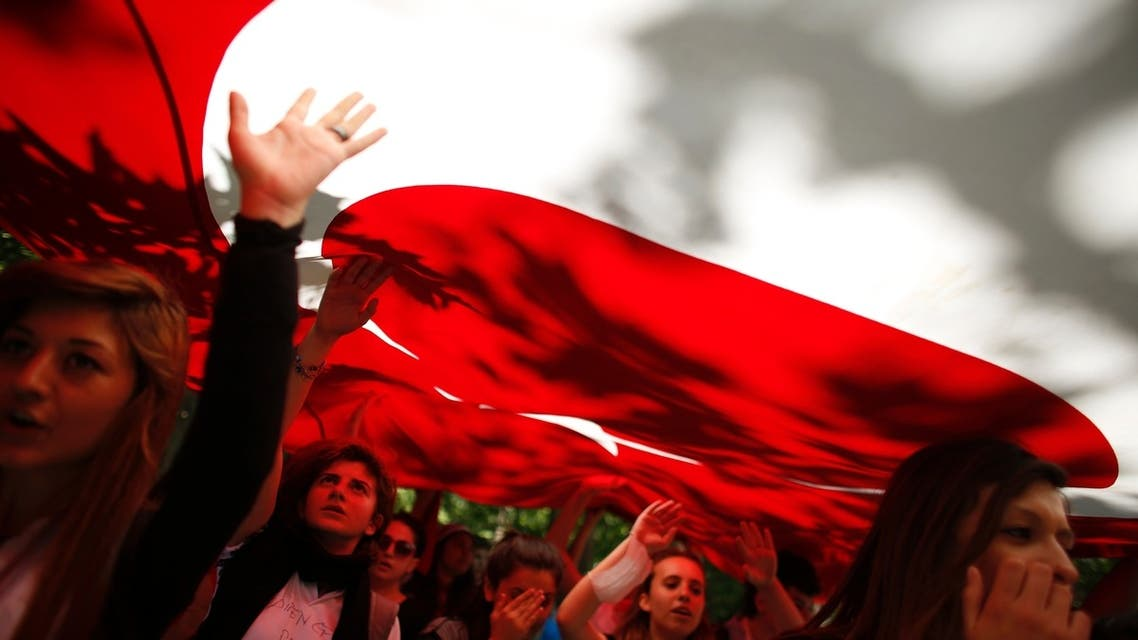 Protesters carry the Turkish flag and shout anti-government slogans during a demonstration at Gezi Park near Taksim Square in central Istanbul June 3, 2013. (Reuters)