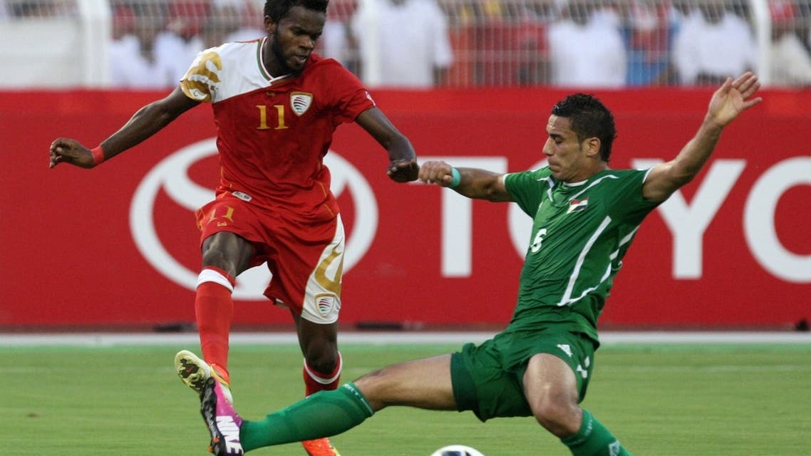 Iraq's Nashat Akram (R) challenges Oman's Saad al-Mukhaini (L) during their group B Asian zone qualifying football match for the 2014 World Cup in Muscat, on June 04, 2013. (AFP)