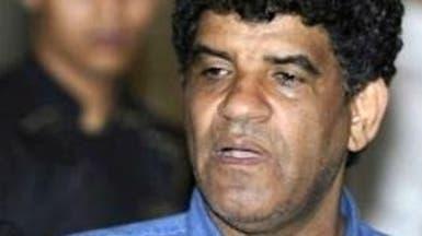محامي السنوسي يدعو لنقله إلى لاهاي منتقداً ظروف اعتقاله