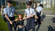 Topless protesters rally outside Merkel office