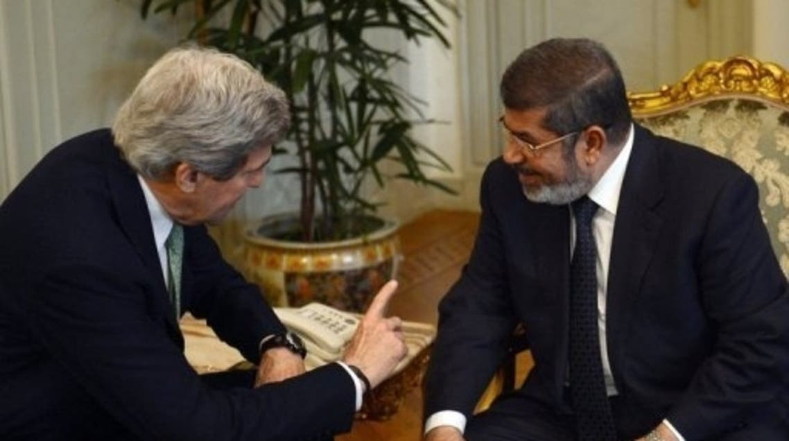 US Secretary of State John Kerry (L) talks with Egyptian President Mohammad Morsi in Cairo on March 3, 2013. (AFP)