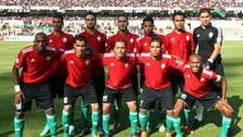 Soldiers and police on patrol for Libya's soccer return