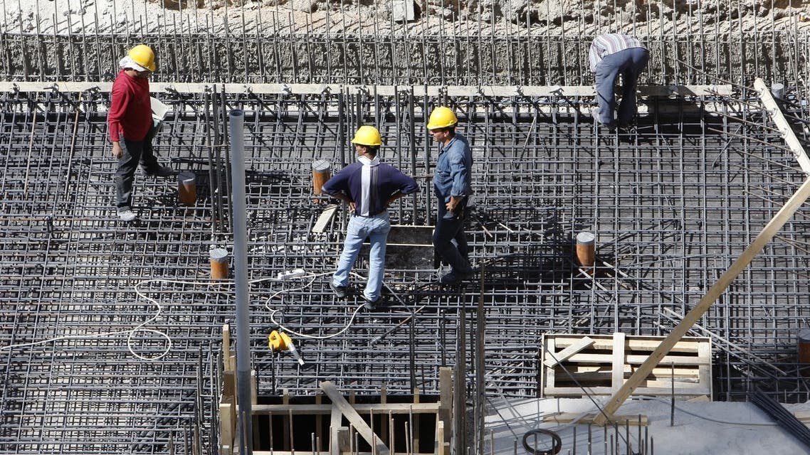 Construction workers in Amman, Jordan, where a consortium led by Dubai's Arabtec has won a $629m contract. (File photo: Reuters)