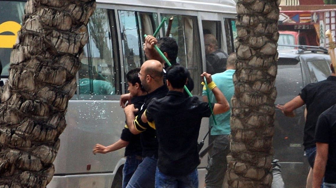 Hezbollah supporters attack a bus carrying anti-Hezbollah protesters in front of the Iranian embassy in Beirut June 9, 2013. REUTERS