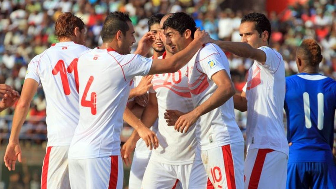 Tunisian players congratulate their teammate Oussama Darragi (2nd R) on June 8, 2013 after he scored against Serra Leone during a 2014 World Cup qualifying football match at the Freetown stadium. (AFP)