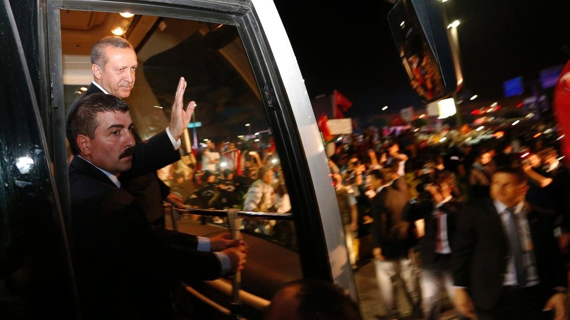 Turkey's Prime Minister Tayyip Erdogan (2nd L) waves to supporters after arriving at Istanbul's Ataturk airport early June 7, 2013. reu