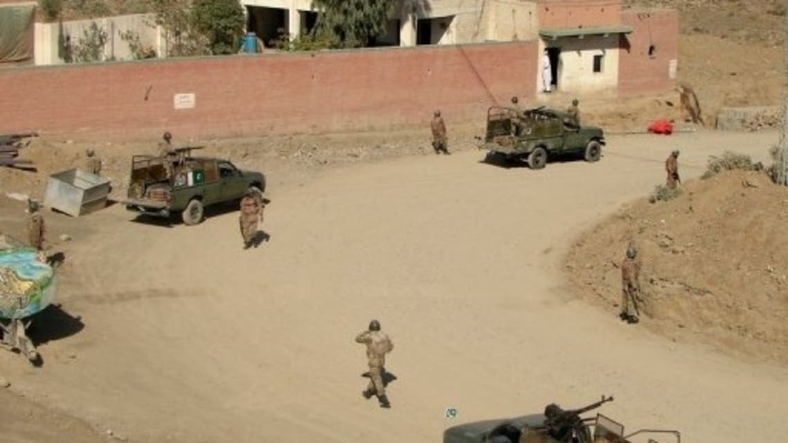Pakistani soldiers patrol following a bomb blast in Miranshah, the main town in North Waziristan, on May 10, 2013. (AFP)