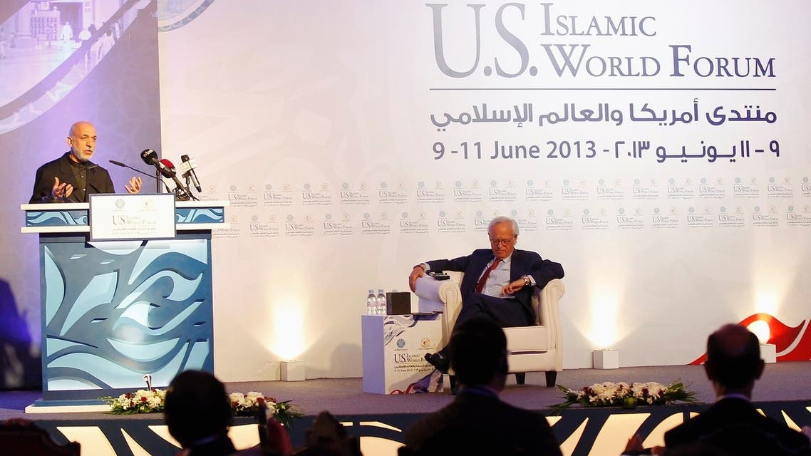 Afghanistan's President Hamid Karzai (L) speaks during the U.S.- Islamic World Forum in Doha June 9, 2013. (Reuters)