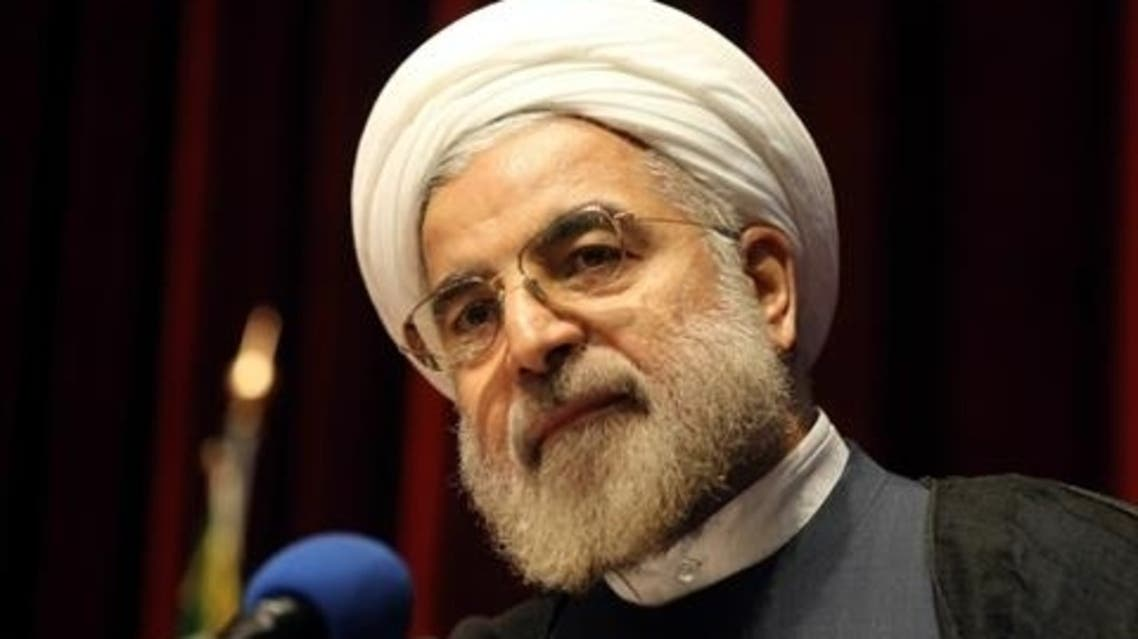 Iran's former top nuclear negotiator Hassan Rohani addresses a ceremony where he announced his candidacy for the upcoming presidential election in Tehran on April 11, 2013. (AFP)