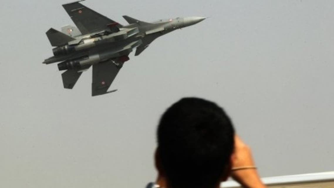 Visitors watch a fighter jet perform during the Aero India Show in Bangalore on February 7, 2013 (AFP/File)