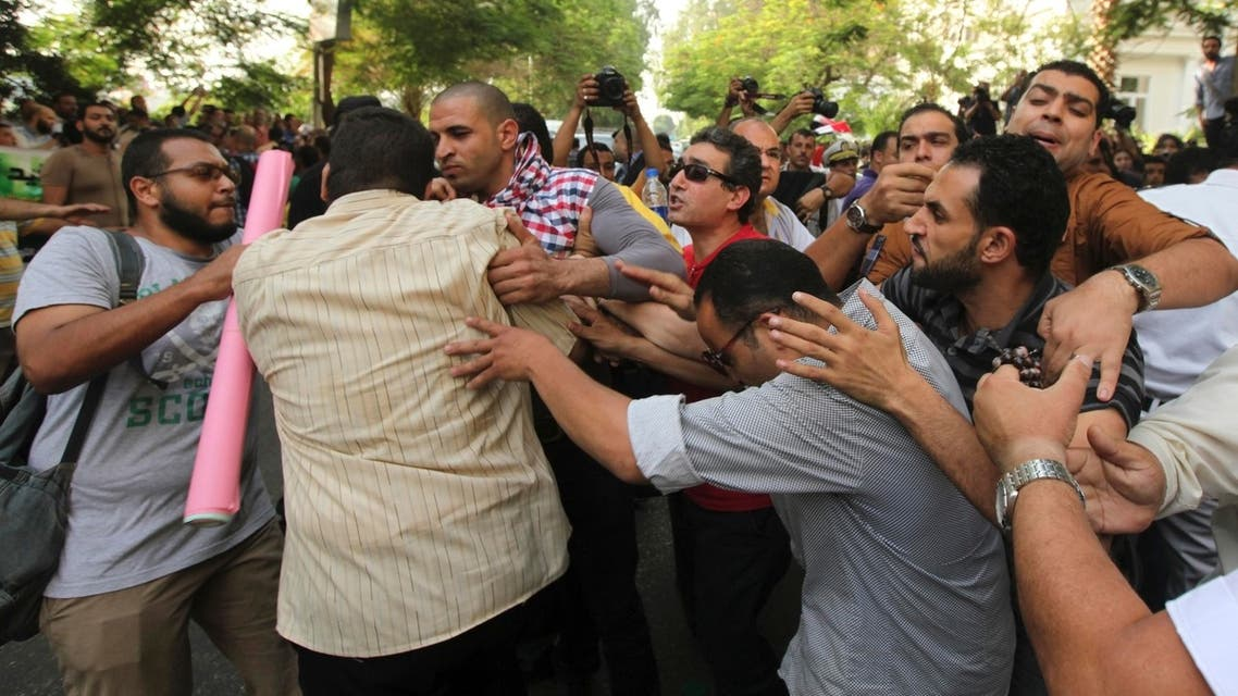 Anti-Mursi protesters, made up of intellectuals and artists, clash with supporters of Egyptian President Mohamed Mursi in front of the Ministry of Culture REUTERS
