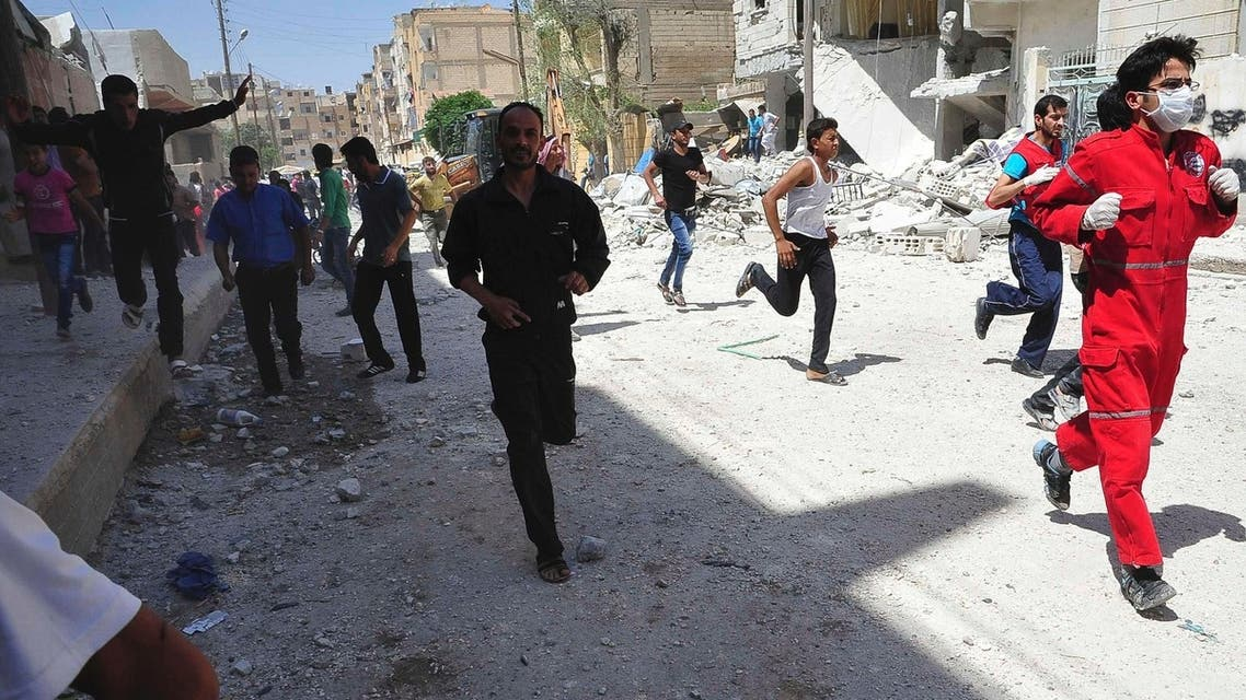 People run for cover after what activists said was shelling by forces loyal to Syria's President Bashar al-Assad in Raqqa province, eastern Syria June 10, 2013. (Reuters)