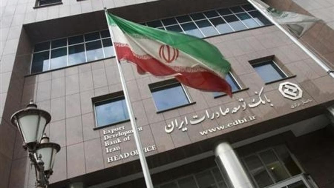 An Iranian flag flutters in front of the head office of the Export Development Bank of Iran (EDBI) in Tehran.(File Photo: Iran)