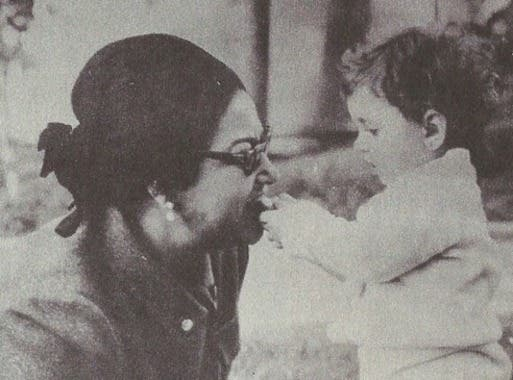 This picture shows Egyptian diva Umm Kolthoum playing with a baby. (Photo courtesy: Facebook)