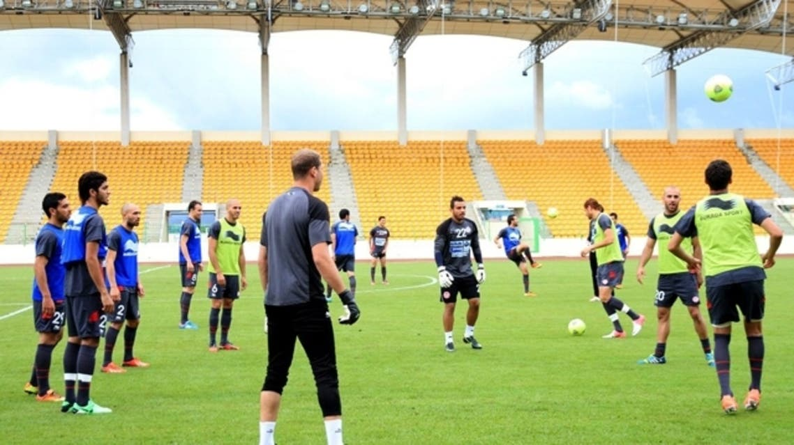 Tunisian football team players warm up during a training session at the Malabo stadium in Guinea on June 15, 2012 ahead of their 2014 World Cup qualifying football match against Equatorial Guinea. (AFP)