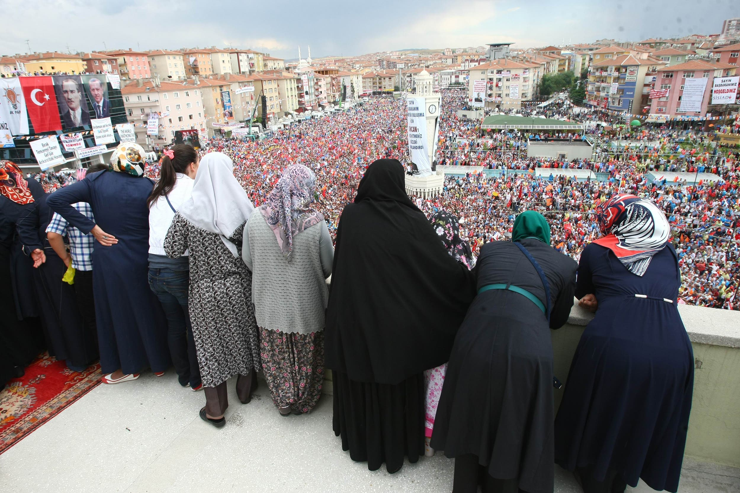 Supporters listen to a speech by Turkish prime minister during a rally in Sincan on June 15, 2013. (AFP)