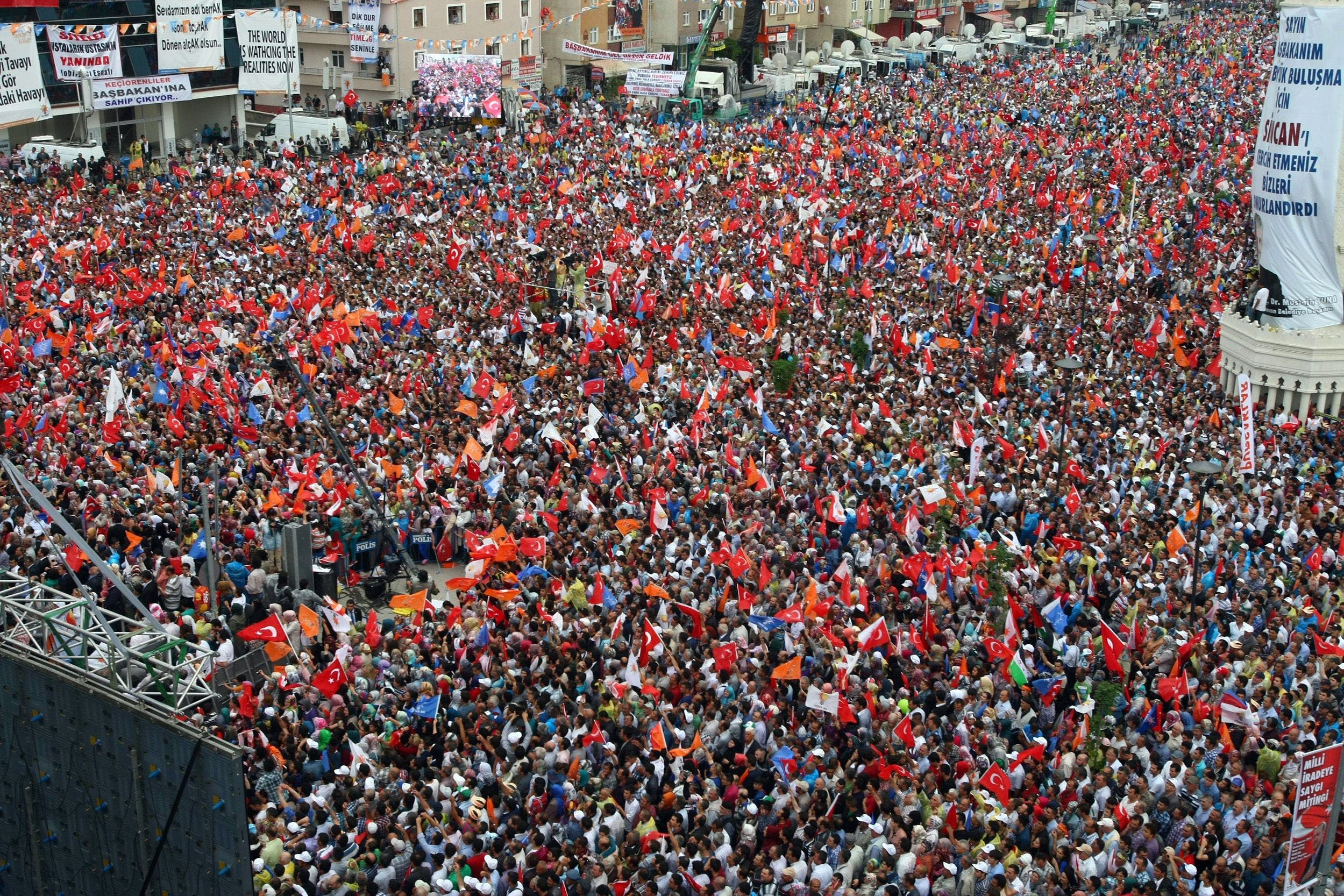 Supporters of Turkish Prime Minister Recep Tayyip Erdogan listen to him speak during a rally in Sincan, on June 15, 2013. (AFP)
