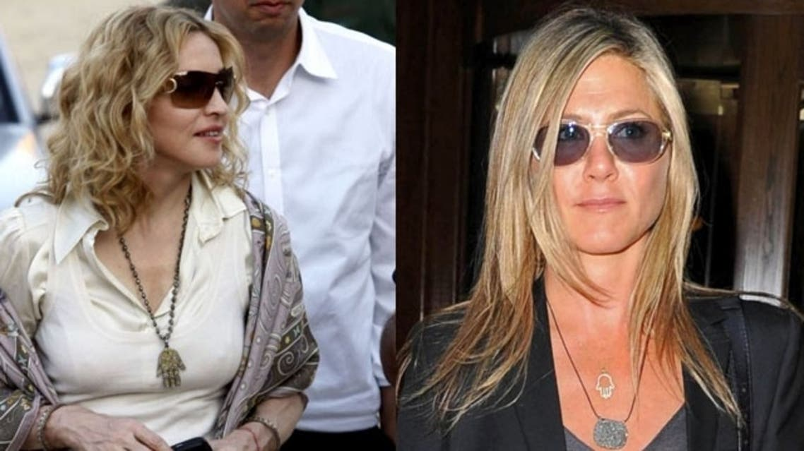 """Jennifer Aniston and Madonna are just some of the stars that have been spotted wearing necklaces and bracelets with the """"hamsa,"""" a hand-shaped amulet with an """"evil eye"""" symbol. (Photo courtesy: WENN.com and FilmMagic)"""