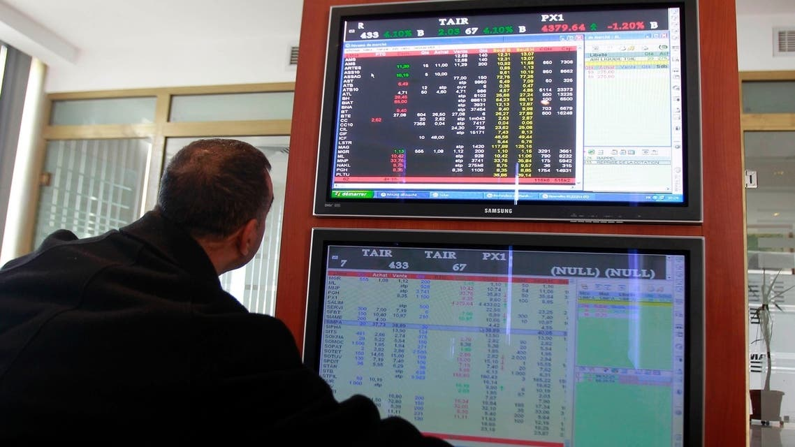 An investor monitors a screen at the Tunisia Stock Exchange. Islamic finance is forecast to take a 25 to 40 percent share of the sector by 2018. (File photo: Reuters)