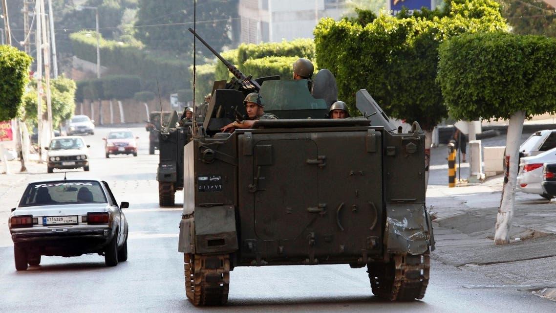 Lebanese army soldiers patrol a street in Abra, near Sidon, southern Lebanon, June 18, 2013. (Reuters)