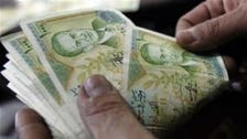 Syrian pound tumbles to record low on talk of rebel aid