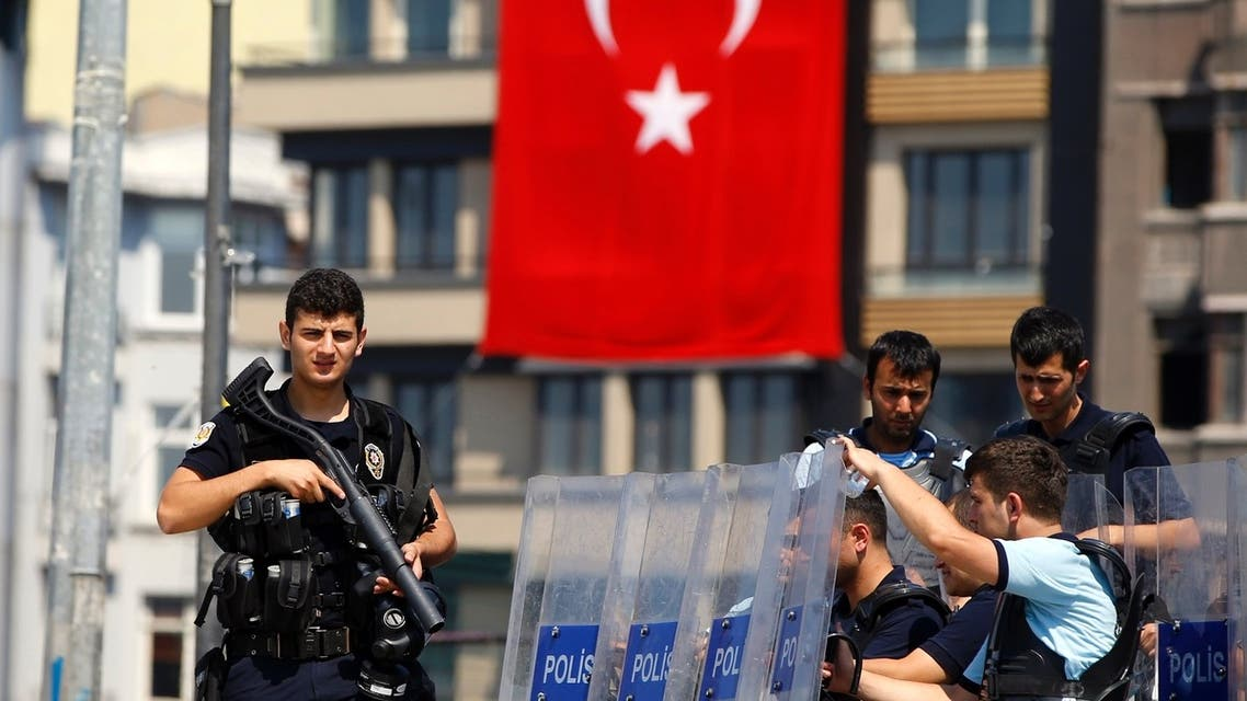 Turkish police stand guard at the entrance of Gezi Park at Taksim Square in Istanbul June 17, 2013.