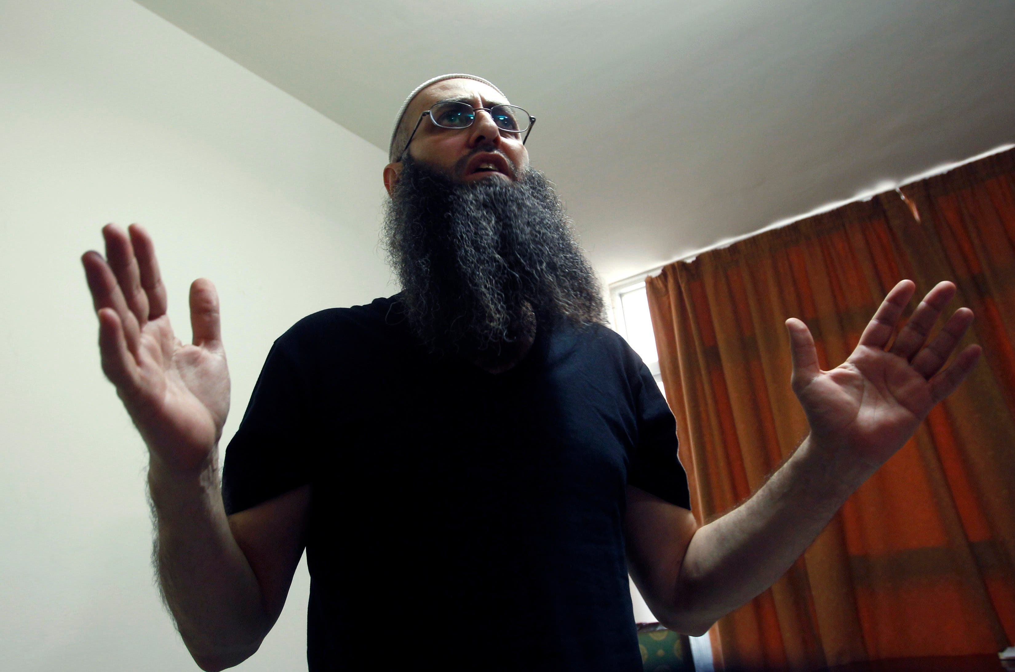 Sunni Muslim Salafist leader Ahmad al-Assir gestures as he speaks in his office in Abra, near Sidon REUTERS