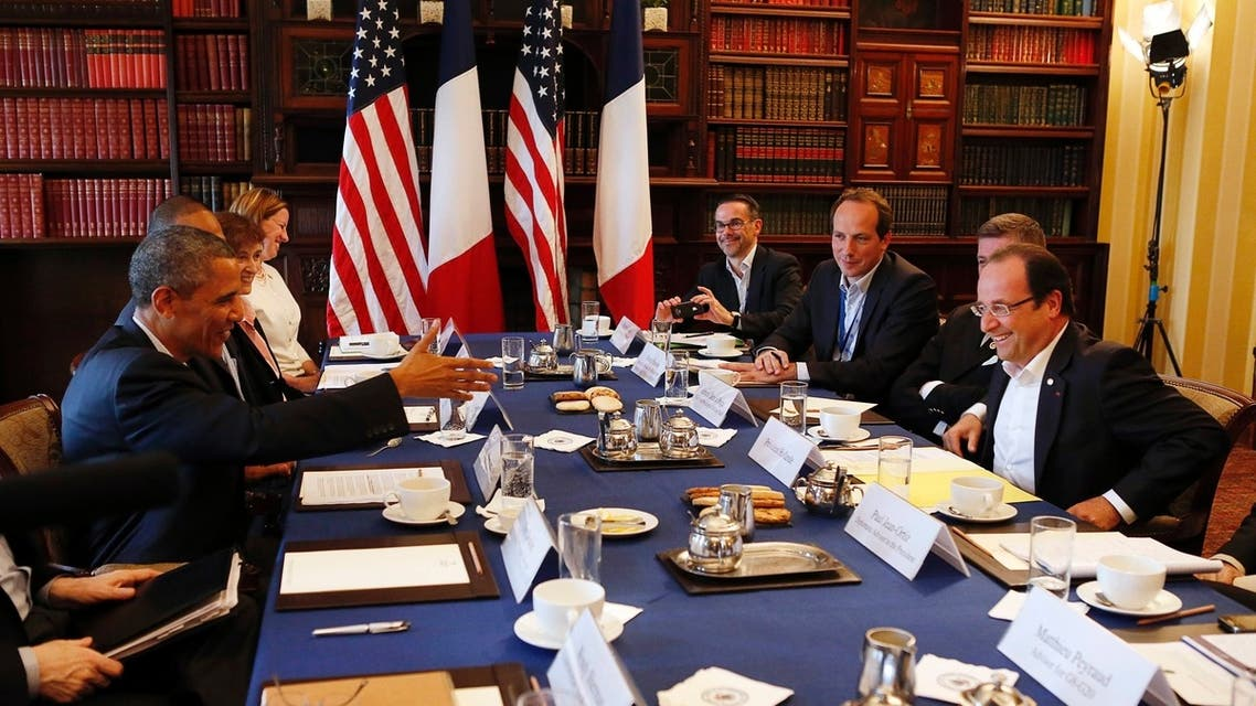 U.S. President Barack Obama (L) meets with French President Francois Hollande during their meeting at the G8 Summit in Enniskillen, Northern Ireland June 18, 2013. (File photo: Reuters)