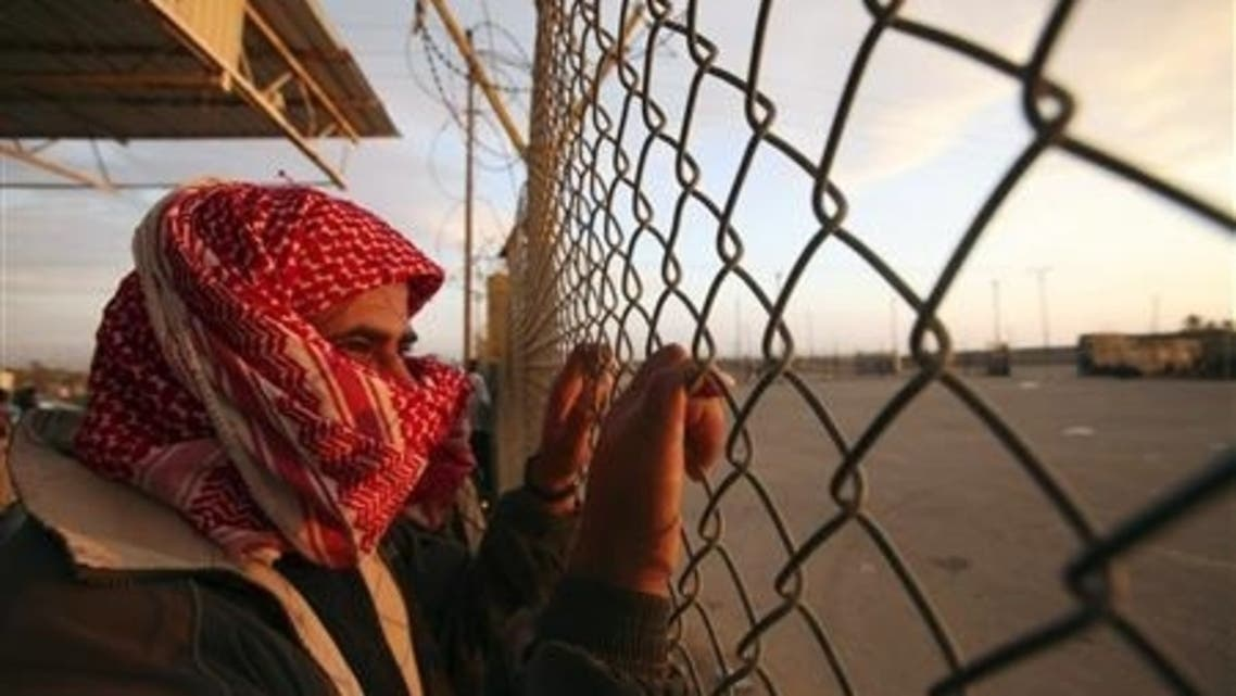 A Palestinian man waits for his relatives to cross the Rafah border crossing into the southern Gaza Strip December 8, 2009, after performing the annual haj pilgrimage in Mecca. (File photo: Reuters)