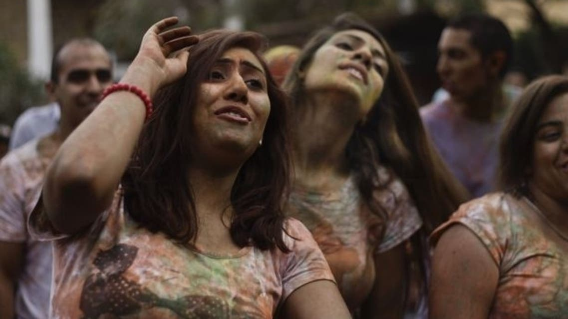 """In this Saturday, April 6, 2013 photo, Egyptian ladies dance during a """"Mahraganat"""" Arabic word for """"festivals,"""" concert by music singers, in Cairo, Egypt. (Photo courtesy: Associated Press)"""