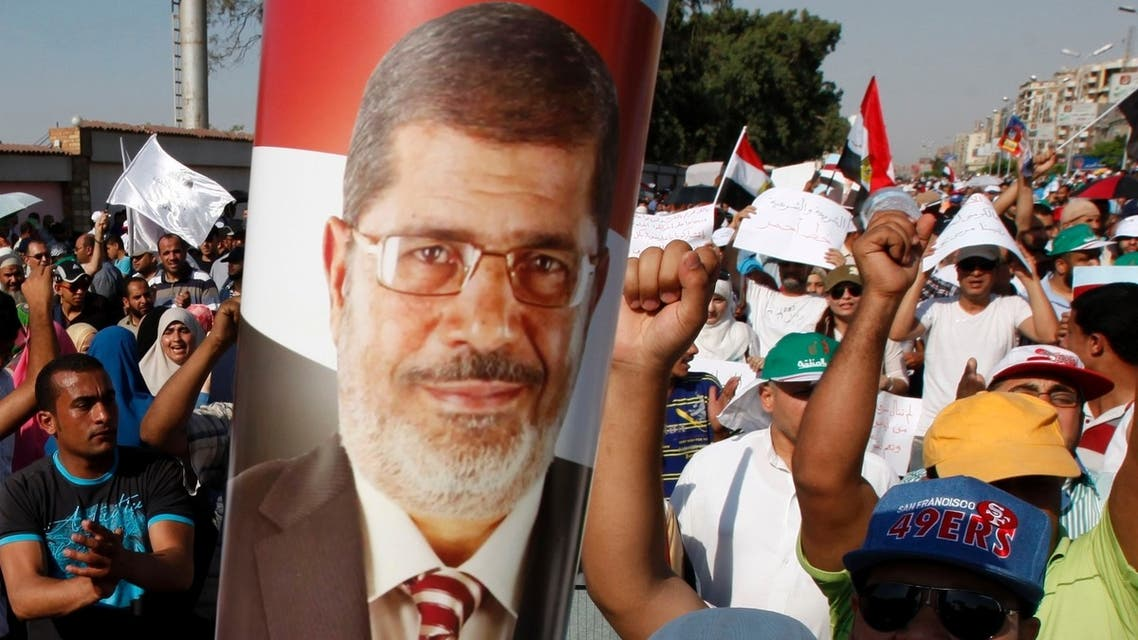Supporters of Egyptian President Mursi shout slogans during protest around Raba El-Adwyia mosque square in Cairo June 21, 2013. (Reuters)